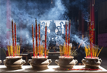 Incense burning in urns and worshippers in the Chua On Lang Pagoda in Ho Chi Minh City, Vietnam, Indochina, Southeast Asia, Asia