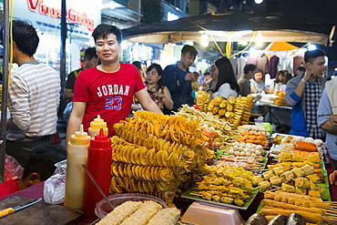 Chips and skewers on sale at a night market in the Old Quarter of Hanoi, Vietnam, Indochina, Southeast Asia, Asia
