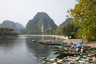 Row boats in Tam Coc used to take tourists around the Trang An Landscape Complex in Ninh Binh Province, Vietnam, Indochina, Southeast Asia, Asia