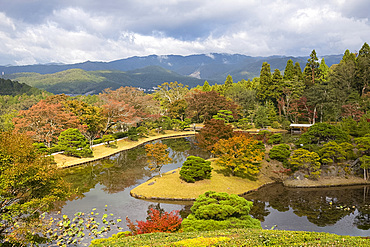An aerial view of Yokuryuchi Pond surrounded by autumn foliage at the Shugakin Imperial Villa Garden, Kyoto, Japan, Asia