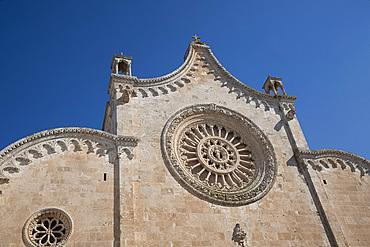 The rose window on the Cathedral of Santa Maria dell Assunzione in Ostuni, Puglia, Italy, Europe