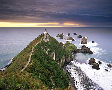 Nugget Point lighthouse on the coast and overcast sky, the Catlins, South Island, New Zealand, Pacific