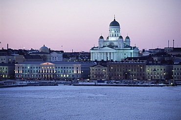 Dusk light on the Lutheran Christian cathedral in winter snow, across the frozen Baltic Sea, Helsinki, Finland, Scandinavia, Europe