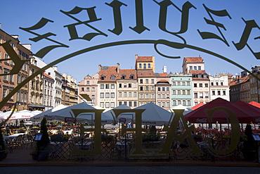 Colourful houses of the Old Town Square (Rynek Starego Miasto) viewed through a cafe window, Old Town (Stare Miasto), UNESCO World Heritage Site, Warsaw, Poland, Europe