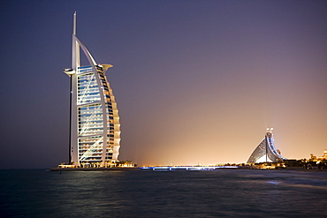 The iconic symbol of Dubai, the Burj Al Arab, the world's first seven star hotel (classified as five star deluxe), built on an artificial island offshore from the Jumeirah Beach Hotel, Dubai, United Arab Emirates, Middle East