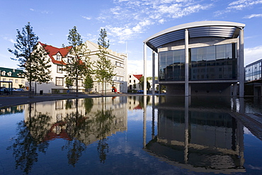 The Radhus (City Hall), an angular construction of concrete, glass and carved lava, Lake Tjorn, Central area, Reykjavik, Iceland, Polar Regions