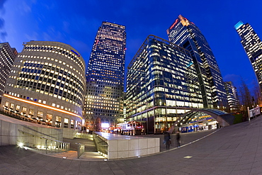 Financial District office buildings illuminated at dusk, Canary Wharf, Docklands, London, England, United Kingdom, Europe