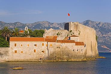Town beach looking towards the walls of Stari Grad (Old Town), Budva, Montenegro, Balkans, Europe