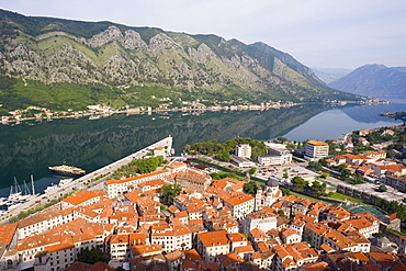 Elevated view over the Old Town, fjord and mountains from the walls of the Kotor Fortress which forms a continuous belt around the Old Town, Kotor, Bay of Kotorska, Adriatic coast, Montenegro, Europe