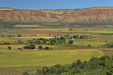 Landscape of fields and farms with rock cliffs in the background, in Colorado, United States of America, North America
