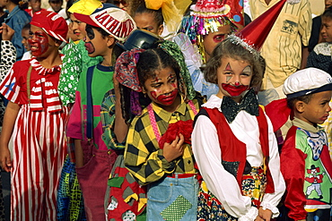Portrait of children with painted faces during the Mardi Gras Festival in the city of Mindelo, Sao Vicente Island, Cape Verde Islands, off West Africa, Africa