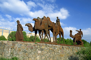 Statues of camels and camel drivers on Silk Road monument near the Registan in Samarkand, Uzbekistan, Central Asia, Asia
