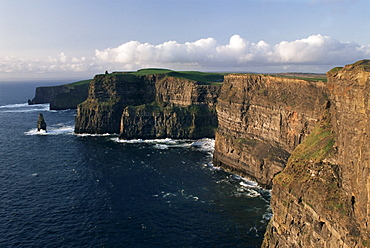 The Cliffs of Moher, rising to 230m in height, O'Brians Tower and Breanan Mor seastack, looking from Hags Head, County Clare, Munster, Eire (Republic of Ireland), Europe