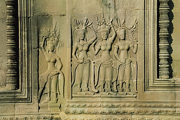 Stone bas reliefs depicting scenes of rural life and historical events on the walls of Angkor Wat, UNESCO World Heritage Site, Siem Reap, Cambodia, Indochina, Southeast Asia, Asia