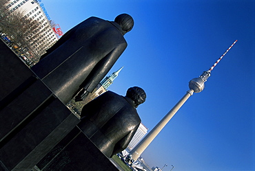 Statues of Marx and Engels, with TV Tower or Fernsehturm beyond, Berlin, Germany, Europe