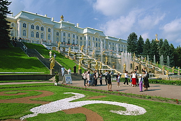 Tourists in front of fountains outside the Summer Palace at Petrodvorets in St. Petersburg, Russia, Europe