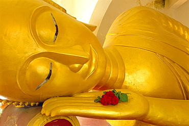 Close up of the head of a reclining Buddha statue, Wat Pha Baat Tai, Luang Prabang, Laos
