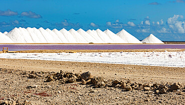 Stacks of salt beside large salt pans, Bonaire, ABC Islands, Dutch Antilles, Caribbean, Central America