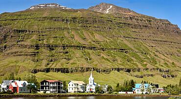 Seydisfjordur, benreath hillside of basalt lavas, eastern Iceland