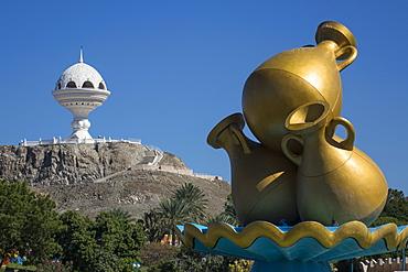 Golden sculpture on road roundabout & Incense burner (Riyam monument), Muscat, Oman, Middle East