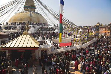 People walking round base of stupa during Lhosar, the Tibetan and Sherpa New Year festival, Bodhnath Buddhist Stupa, UNESCO World Heritage Site, Bagmati, Kathmandu, Nepal, Asia