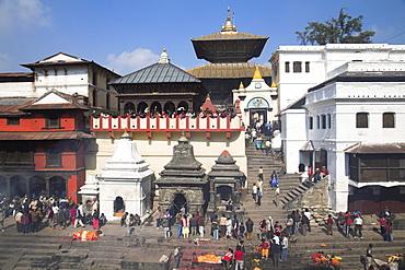 Cremation ceremony on banks of Bagmati River at Shivaratri festival, Pashupatinath Temple, UNESCO World Heritage Site, Kathmandu, Nepal, Asia