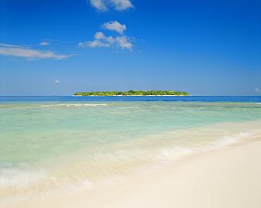 The tropical island of Bandos from Kuda Bandos (Little Bandos), North Male Atoll, the Maldives, Indian Ocean
