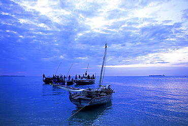 Fishing boats on the Indian Ocean at dusk, off Stone Town, Zanzibar, Tanzania, East Africa, Africa