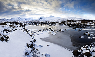 Winter view across Lochain na h'achlaise to the Black Mount hills at dusk, Rannoch Moor, Highland, Scotland, United Kingdom, Europe