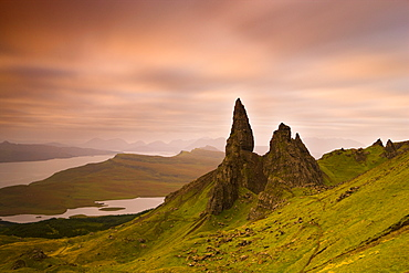 Old Man of Storr at dawn with Cuillin Hills in distance, near Portree, Isle of Skye, Highland, Scotland, United Kingdom, Europe