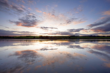 View across the Aln Estuary at sunset, Alnmouth, near Alnwick, Northumberland, England, United Kingdom, Europe