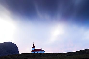 Hilltop church against twilight sky, Vik i Myrdal, southern area, Iceland, Polar Regions