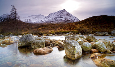 River Coupall, just above the Coupall Falls, looking towards snow-covered mountains, Glen Etive, Highland, Scotland, United Kingdom, Europe