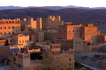Traditional kasbahs (fortified houses) bathed in evening light in the town of Nkob, near the Jbel Sarhro mountains, Morocco, North Africa, Africa