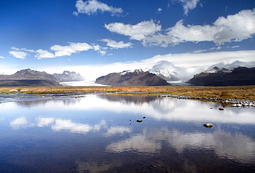 Mountains and glaciers on the edge of the Vatnajokull Ice Cap near Skaftafell National Park, reflecting in a nearby lake, South Iceland, Iceland, Polar Regions