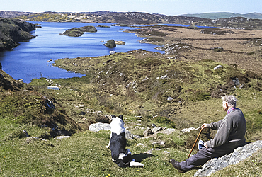 Man and dog, Lough Doon, Co Donegal, Ireland *** Local Caption ***