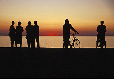 People watching sunset, Visby, Gotland, Sweden *** Local Caption ***
