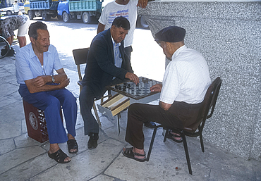 Men playing board game, Kos, Greece *** Local Caption ***