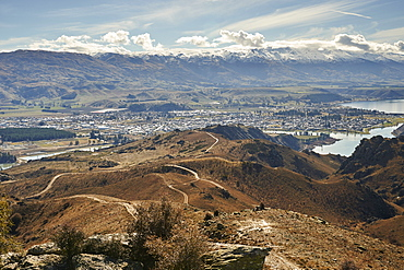View to outskirts of Cromwell over man-made Lake Dunstan and gold-mining excavations beyond, Otago, South Island, New Zealand, Pacific