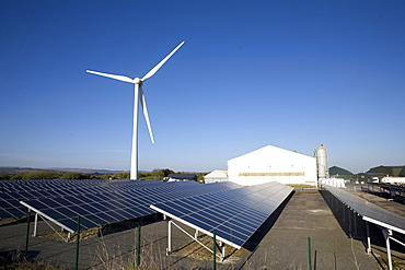 Three types of renewable electricity generation on Newton Down, wind turbine, solar panels and, in the shed, anaerobic digestion, Newton Down, Porthcawl, South Wales, United Kingdom, Europe