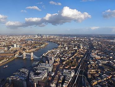 Aerial cityscape showing River Thames, Tower Bridge and railway tracks, London, England, United Kingdom, Europe