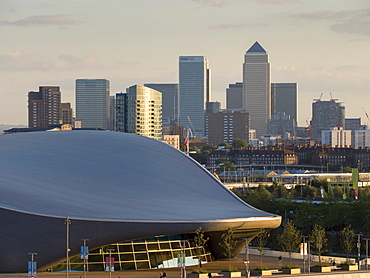 Olympic Park Aquatic Centre with Docklands and Canary Wharf skyline behind, London, England, United Kingdom, Europe