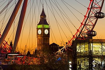 London Eye (Millennium Wheel) frames Big Ben at sunset, London, England, United Kingdom, Europe