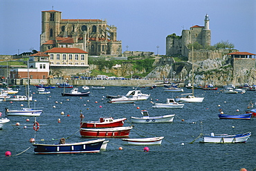 Boats moored in harbour and the 12th century church of Santa Maria, Castro Urdiales, Cantabria, Spain, Europe