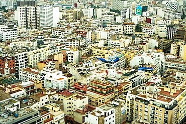 Aerial cityscape, patterned abstract of numerous white and yellow modern buildings, Casablanca, Morocco, North Africa, Africa