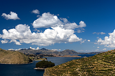 Aerial view from the top of Sun Island across deep blue Lake Titicaca to the mainland, Bolivia, South America