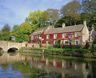 The Swan Hotel reflected in the river at Bibury in the Cotswolds, Gloucestershire, England, United Kingdom, Europe