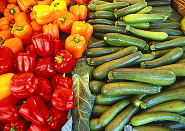 Red Peppers, Yellow Peppers and Courgettes on a Market Stall