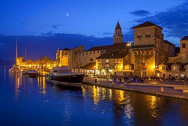 Waterfront lit up at dusk, Trogir, UNESCO World Heritage Site, Dalmatian Coast, Croatia, Europe