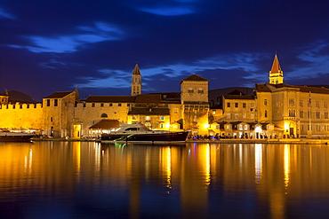 View of city across river, lit up at dusk, Trogir, UNESCO World Heritage Site, Dalmatian Coast, Croatia, Europe